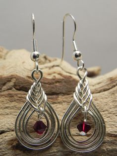 Earrings - Celtic Knot Silver Plated Wire-Worked with Siam Swarovski Crystal Bead. $16.00, via Etsy.