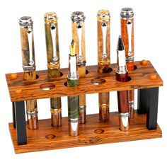 Shop Rosewood Exotic Hardwood Executive 9 Pen Display created by lanierpens. Pen Holder Diy, Wooden Pen Holder, Pen Storage, Fine Pens, Pen Turning, Wood Turning Projects, Fountain Pen Ink, Pen Case, Writing Instruments