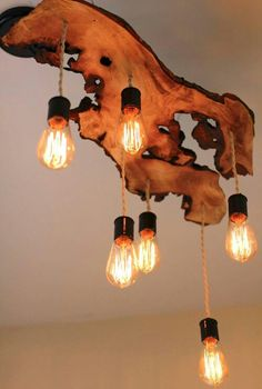 Raw edge wood slab with vintage Edison pendant lights.