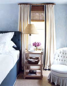 """Roberts balanced masculine and feminine in the guest room with blues, teals, and browns: """"We wanted the room to be comfortable for both men and women."""" Curtain rods are painted to look like bamboo.   - HouseBeautiful.com"""