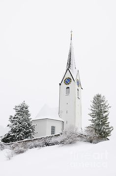 Beautiful church in winter, lots of snow. Minimalist, serene and calming picture. Parish church St. Anna in Hirschegg, Kleinwalsertal valley, Austria, Europe. Available as poster and print (framed, canvas, metal, acrylic) here: http://matthias-hauser.pixels.com/featured/church-in-winter-matthias-hauser.html (c) Matthias Hauser hauserfoto.com - Art for your Home Decor and Interior Design needs