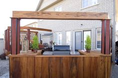 """A closer look at the details of the exotic hardwood screen built in behind the barbeque.  Decks should be beautiful from all angles!  From """"Decked Out"""" project """"The Kids' Deck"""".  Deck Design by Paul Lafrance Design."""
