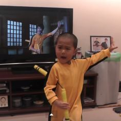 Watch this incredible 5yo reenact a scene from a Bruce Lee movie, movement for movement— without even watching the screen!
