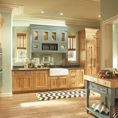 Another shot of that cool sage-blue color with oak cabinets