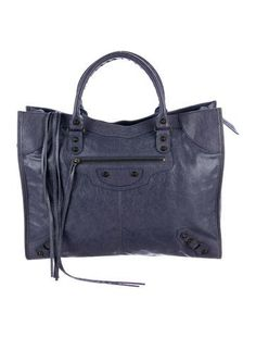 From the 2016 Collection. Blue Roi calfskin leather Balenciaga Papier A4 tote with silver-tone hardware, dual rolled shoulder straps, single exterior zip pocket, stud and buckle embellishments at front, tonal leather lining, dual interior slit pockets and open top. Includes compact mirror. Shop Balenciaga consignment handbags at The RealReal.