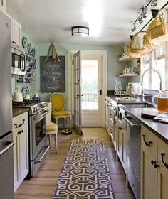 kitchen - wood floors, white cabinets, dark counters. Paint color!!