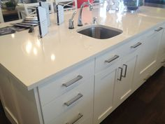 White quartz countertop with white mission style cabinets