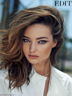 Classy in white: Bold lashings of black mascara and a light slick of lipstick with a stroke of bronzer along her cheekbones made up the model's picture perfect look