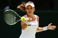 Agnieszka Radwanska of Poland plays a forehand shot during her Ladies' Singles second round match against Casey Dellacqua of Australia on day three of the Wimbledon Lawn Tennis Championships at the All England Lawn Tennis and Croquet Club at Wimbledon on June 25, 2014 in London, England. (Photo by Steve Bardens/Getty Images)