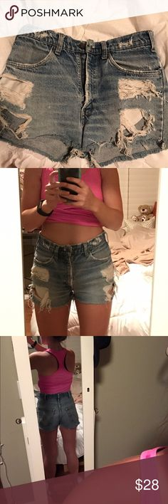 Levi High Waisted Distressed Denim Shorts Urban Outfitters Levi's shorts. Distressed. Worn many times, but still have a lot of life left in them. Hit right above belly button. Not cheeky, but not long. Perfect amount of coverage. Levi's Shorts Jean Shorts