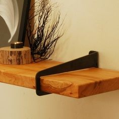 Wall-Stirrup Shelf Brackets - A simple piece of laser cut and formed steel cantilevers off your wall and accepts a standard 2x10 wood plank to create a shelf width of your choosing.