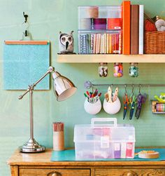 An office for the crafty — love supplies hanging over the desk   Workspaces
