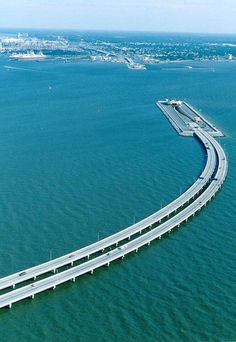 This bridge and tunnel goes under water to allow movement of ships. In order for ships to pass, this bridge is half under the water. You drive down in the water and then come out on the other side. Truly a marvelous piece of engineering! This bridge is between Sweden and Denmark.