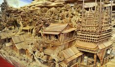 "Chinese woodcarving by sculptor Zheng Chunhui called ""Along the River During the Quinming Festival"" and is a replica of a famous 1,000 year old Song Dynasty scroll painting."