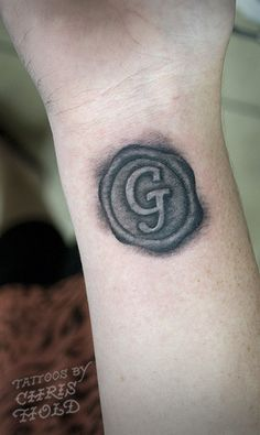 "Wax Seal Tattoo, but I want an emblem and either ""SoS 8:6"" or ""...as a seal upon my heart"" in it as well. Also I want it in red"