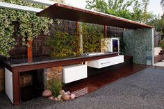 Love the use of iron girders, maybe with concrete countertop?