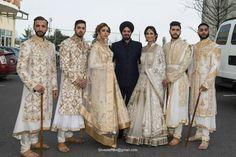 White and gold bridal lehenga and sherwani. Indian wedding outfit