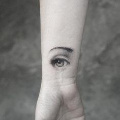 Eye tattoo by Sanghyuk Ko