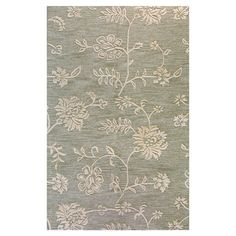 Anchor your living room seating group or define space in the den with this artfully hand-tufted wool rug, featuring a vine motif in teal.  ...