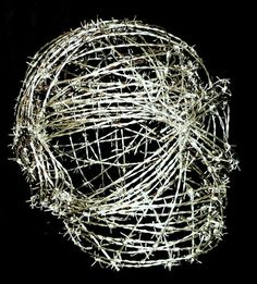 Painful Existence in barbed wire. From a series called The Untouchables. #barbedwireart #sculptoranthonymoman #anthonymomanartist #wireart #skullart #wireskull