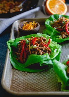 These turkey Asian lettuce wraps are infused with a sticky, sweet, savory and slightly spicy orange sauce making them an irresistibly easy and tasty meal. | @tropicana #grovetoglass #Tropicana70th #sponsored