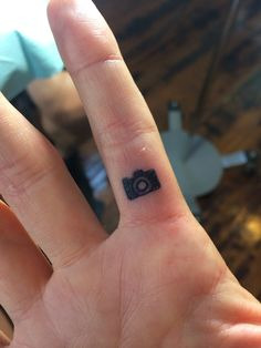 A tiny camera on my shutter finger. by Kurt Elkins at Artfuel Inc.