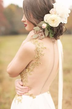 Gorgeous bridal updo and flower accents | 21 Glitzy Gold Wedding Ideas via @perfectpalette
