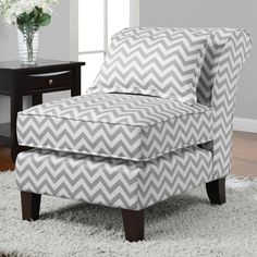 Enhance Your Home Decor With This Stylish Grey And White Slipper Chair. A  Popular Chevron Print And A Durable Construction Complete This Trendy Chair.