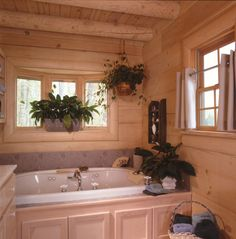 Sitka Rustic Country Log Home Bathroom Photo 01 from houseplansandmore.com