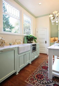 There's so much to love in this kitchen designed by Garrison Hullinger out of Portland, Oregon. The cabinets painted Benjamin Moore HC-120 Van Alen Green are just so, so pretty. The colorful …