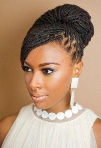 dreadlocks-hairstyle-for-women-bun-with-side-bangs
