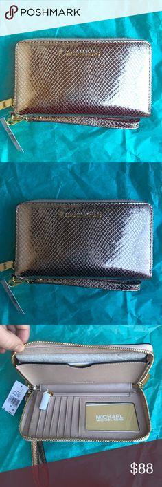 NWT Michael Kors Tech Wallet/Wristlet NWT Authentic Michael Kors Silver Python embossed Wallet/Wristlet. Brand new with tags and cards. Retail $118 Michael Kors Bags Clutches & Wristlets