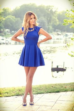 cobalt blue dress with gold jewelry