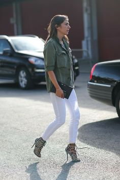 Capucine Safyurtlu in a moss green utility button-up + white skinny jeans + leopard-print lace-up heels