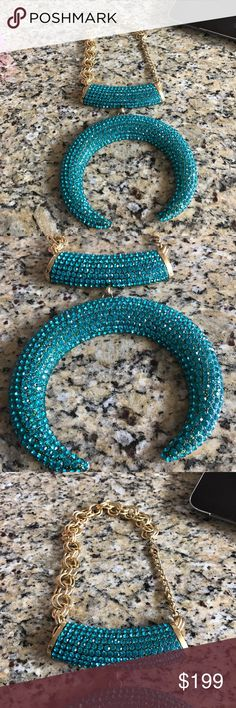 Mint condition XL statement necklace -show stopper This is a show stopper and perfect for a true fashionista! XL horn encrusted with teal rhinestones in gold chain . In mint condition. Purchased two yrs ago in Palm Springs while on vacation . Jewelry Necklaces
