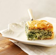 Spanakopita is the Greek spinach pie made with filo pastry - tissue-thin sheets that make for flaky results! It is a savory dish perfect for breakfast, quick snack or lunch! Filo Pastry, Savory Pastry, Savory Tart, Greek Spinach Pie, Greek Pastries, Quick Snacks, Spanakopita, Savoury Dishes, Greek Recipes