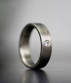 Image of simple gold and diamond wedding band