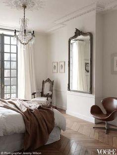 Paris apartment bedroom large antique gilded mirror