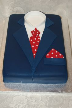 Navy bue suit, red polka dot tie and pocket square cake