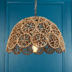 """Jute Rope Macrame Pendant A macrame of recycled metal and jute rope create this lovely pendant. The intricate pattern is well constructed and portrays a delicate lace design. This pendant is well suited for coastal chic to urban cottage interiors. A charming addition over a kitchen island or sunroom table. 100 watt medium base lamp required. (12.5""""Hx20""""W)"""