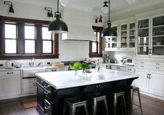 Oh, Lord. This is damn near perfect. Love the old wood paired with crisp blacks and whites and utilitarian-traditional pieces. Kitchen boner.