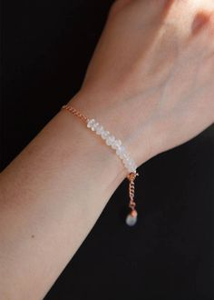 This dainty Rose Gold Bracelet is made with natural Rainbow Moonstone beads, which at first glance appear white but produce beautiful adularescent flashes of blue and purple as you move them against the light. The delicate lobster clasp secures on the chain of the bracelet, making the fit adjustable and leaves a little wire-wrapped Rainbow Moonstone charm dangling playfully. You can wear this bracelet on its own or layer it with other gemstone bracelets. If you are looking for inspiration…