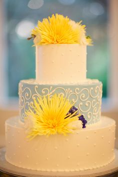 Blue and White Wedding Cake With Yellow Flowers | photography by http://justindemutiisphotography.com/