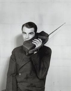 Have come a long way.Motorola employee demonstrating use of a Handie-Talkie portable two-way radio, circa Courtesy of Motorola Inc, Legacy Archives Collection. Radios, Call Me Now, Cell Phone Reviews, Images Vintage, Phone Shop, Vintage Telephone, Old Phone, Two Way Radio, Gadgets And Gizmos