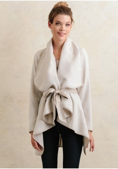 Classic with modern appeal, this gorgeous cream-colored cardigan creates a sophisticated and standout look!