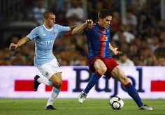 Playing for refugees:  FC Barcelona debuted MÉS jerseys to raise money for UNHCR sports and education projects during a game against Manchester City on August 19.  UNHCR/FCB    FC Barcelona plays Manchester City – and refugee children are the winners.    B #Champions