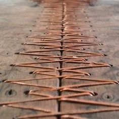 Wood and copper stitching - beautiful!