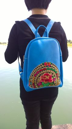 Check out this item in my Etsy shop https://www.etsy.com/listing/214103548/blue-hmong-boho-leather-embroidery-bag