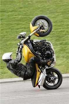 12 o'clock wheelie-is a very high wheelie, past the normal balance point of the motorcycle.