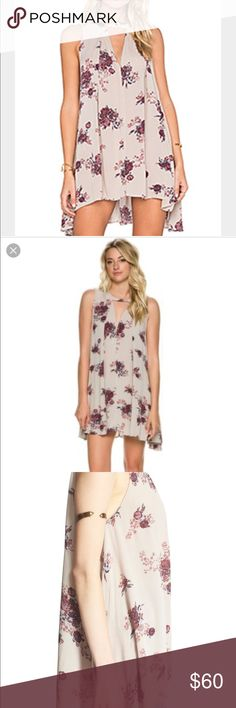 Free People Tree Swing Sleeveless Dress In Floral design. A moody floral print lends a vintage feel to this swingy, crinkled crepe Free People top. The relaxed silhouette is styled with a button closure at the keyhole neckline. Sleeveless. Can be worn as mini dress or flowy shirt! Free People Tops Tunics